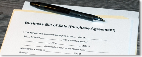 "Physical copy of a mergers and acquisitions contract that's titled ""Business Bill of Sale Purchase Agreement."""