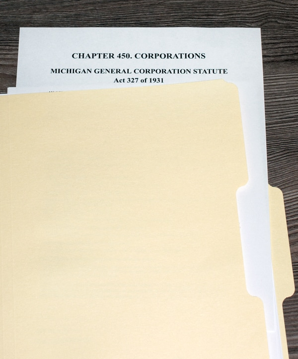 Physical copy of Michigan corporate laws, specifically, the Michigan General Corporation Statute Act of 1931